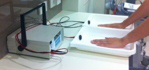 Hands being treated for Hyperhidrosis by Iontophoresis